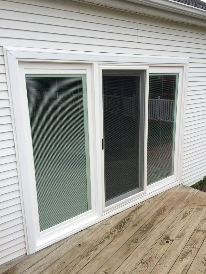 Okna Triple Sliding Patio Door Material: Vinyl Color: White Features:  Blinds Between The Glass That Raise, Lower, And Tilt, Low E Coated Glass,  ...