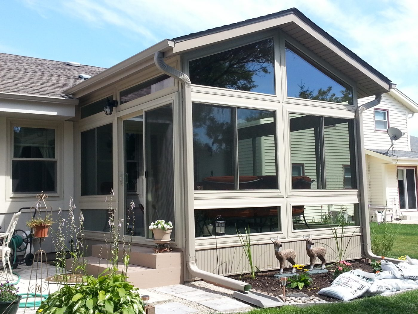Four seasons sunrooms choice windows doors for Transition windows for homes