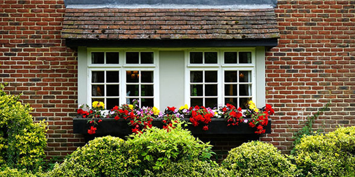 Flowers in window boxes for curb appeal.