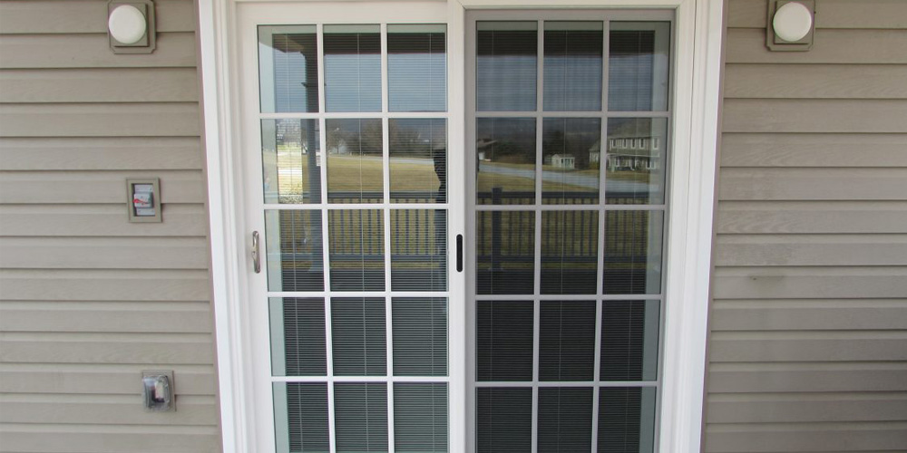 Traditional French Sliding Patio Doors Design Against Tan Siding
