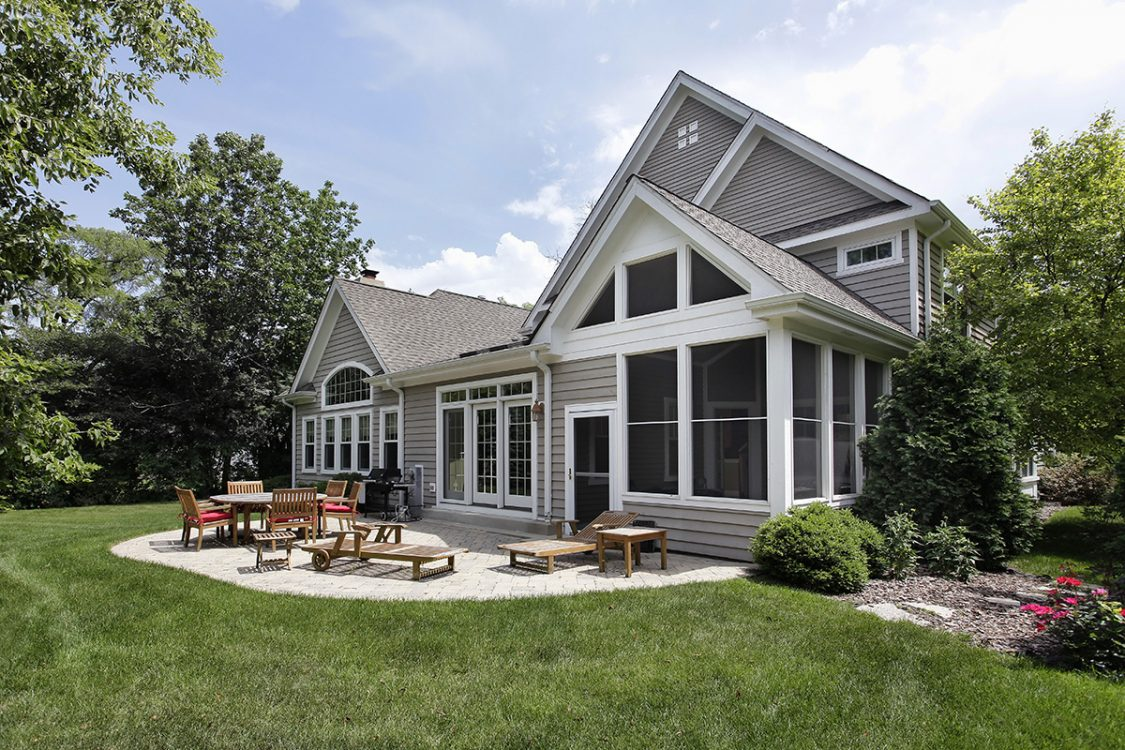 Home Exterior with Gray Siding and White Patio Door Style