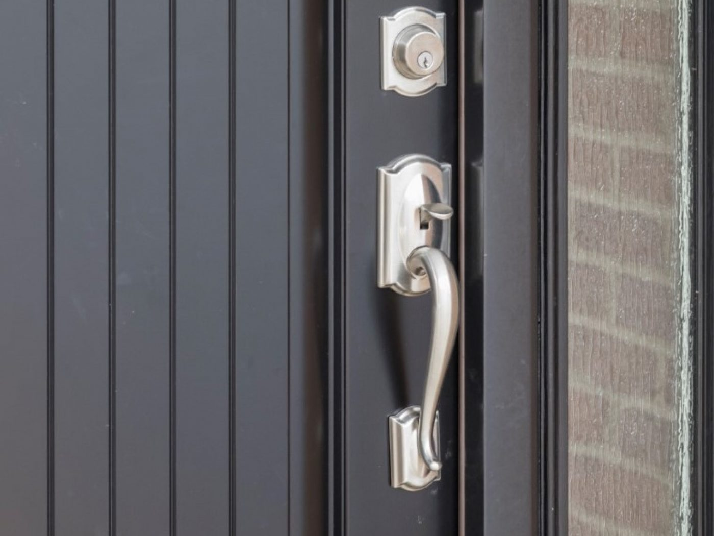 silver door on black handle