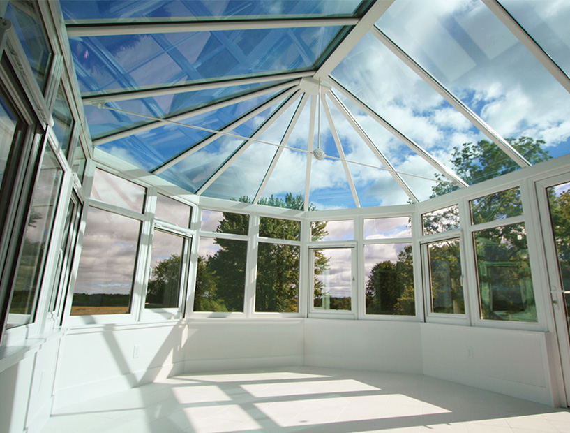 Sunroom surrounded with large windows