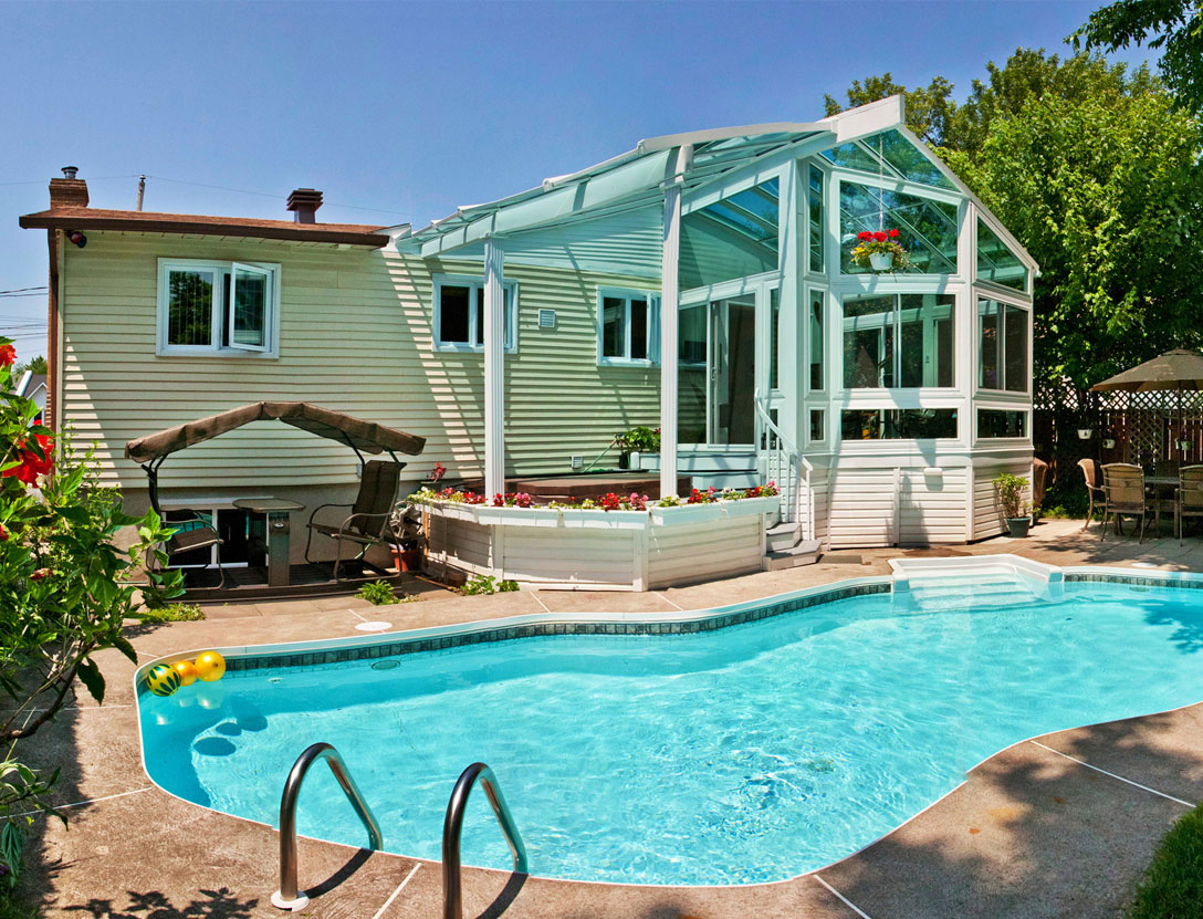 Sunroom exterior style with pool