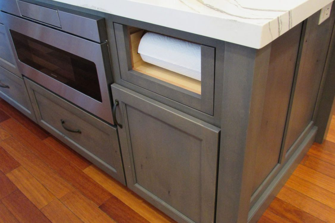 Gray custom cabinets with secret storage
