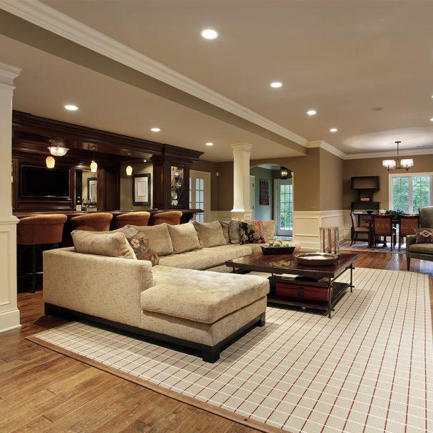 Elegant basement remodel with bar