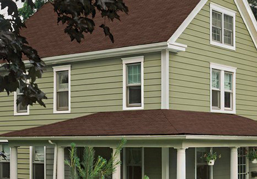 Long lasting green siding on farmhouse