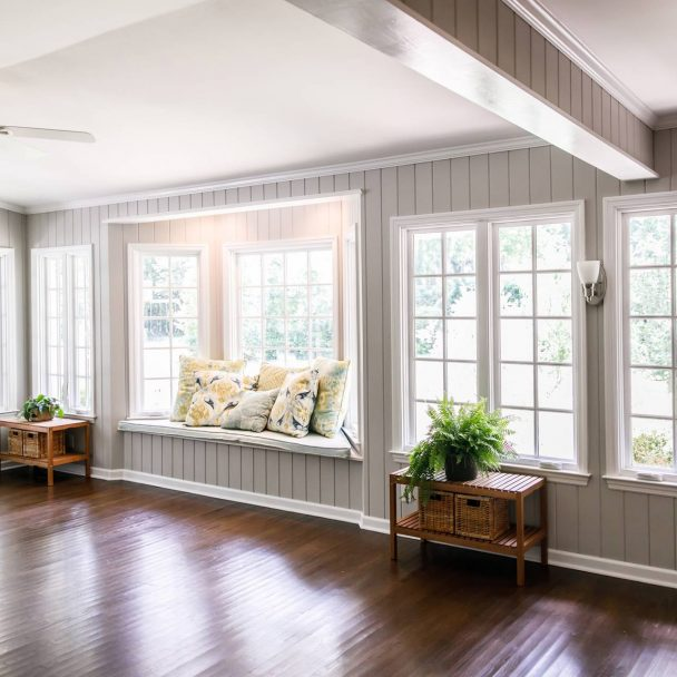 Bay window with gray shiplap wall