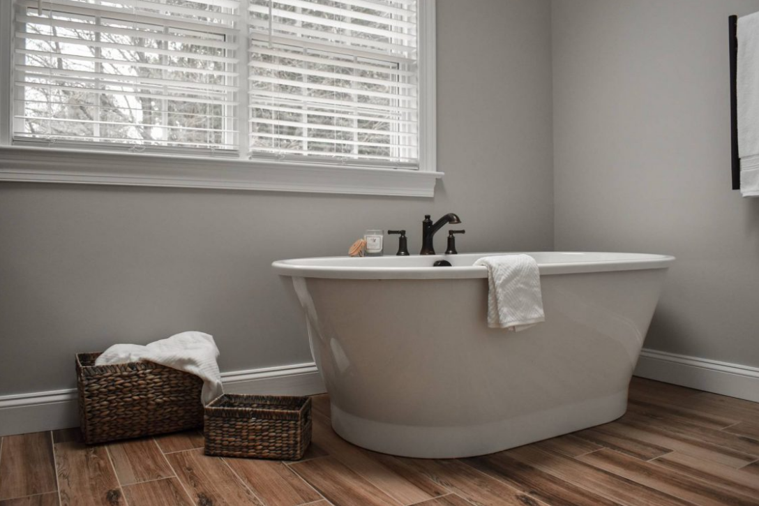 Grand soaking tub by window