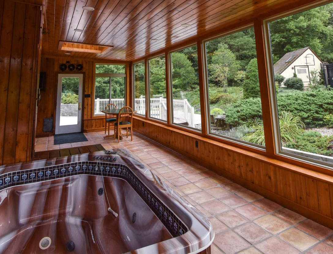 Hot tub in sunroom with nature view